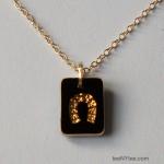 Little Luck Black & Gold Horseshoe Necklace